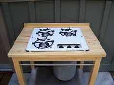 Hack and IKEA table to make an outdoor stove.