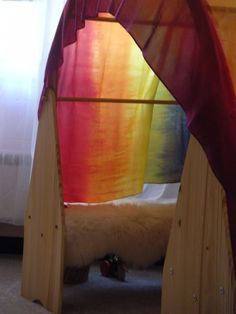 dyeing rainbow silks on a budget; love the waldorf play stands