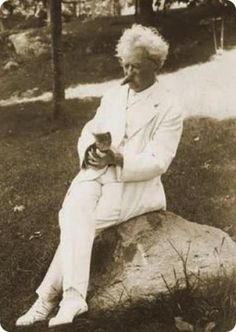 """""""When a man loves cats, I am his friend and comrade, without further introduction.""""—Mark Twain"""