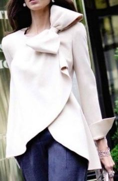 Winter white bow jacket. So chic!