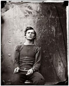 Taken 1865 by Alexander Gardner of Lewis Powell (also known as Lewis Payne), who attempted to murder Secretary State William Seward on April 14, 1865 - the same night that Lincoln was assassinated. He was a part of a conspiracy to kill the central figures of the United States government. He stabbed Seward but failed to kill him.  Shown here in irons on board the U.S.S. Saugus. He was executed on July 7, 1865 with three other conspirators.