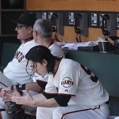 San Francisco Giants pitcher Tim Lincecum sits in the dugout during the fourth inning of a baseball game against the San Diego Padres in San Francisco, Wednesday, July 25, 2012