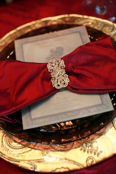 Elegant place settings with red and gold