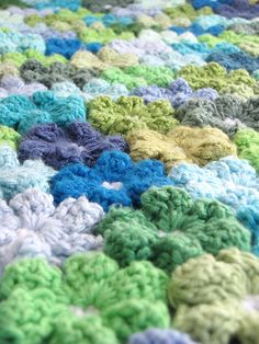 Crochet- puffy floral baby blanket.