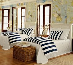 this would be so cute for a guest room or a room at a lake house.  maps on walls. navy and white stripe on white bedding. french doors stained. trim white. wood floors.