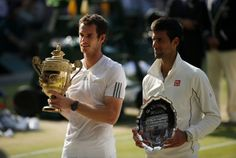 Great Britain's Andy Murray (left) with his winners trophy next to runner up Serbia's Novak Djokovic following the men's final at Wimbledon. Picture: Jonathan Brady/PA Wire