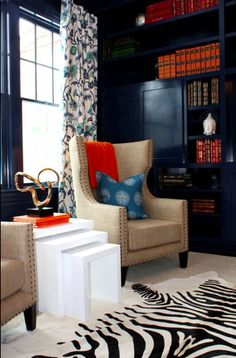 navy walls, black and white rug