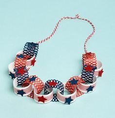 This garland is Americana and I think a little nautical.  The rings made with the punch look like nets!  So cute!