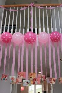cute streamers and balloons with pictures hanging from ends of streamers.