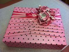 My co-worker asked me to wrap her baby shower gift for her friend Lena. She provided all the materials used.