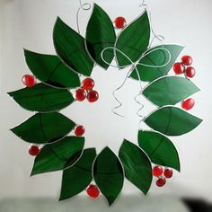 Holiday Wreaths.... Learn the art of stained glass by creating a suncatcher to decorate your window. You'll learn the basics of cutting stained glass, copper foiling and soldering. We have many different snowflake and holiday patterns for your selection! On my wish list qutoes from http://www.mnartists.org/event.do?rid=277040
