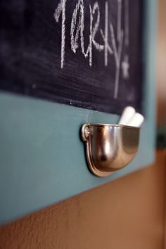 Chalk holder attached to your chalkboard - an upside down drawer pull