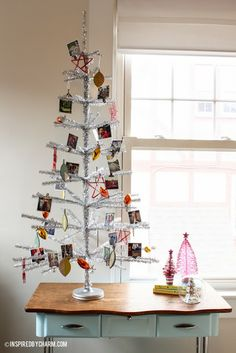 It's an Instamas Tree! Easily decorate a small tinsel tree with all your printed instagrams from the past year!