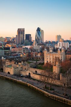 the ancient architecture of London Tower and Tower Bridge contrast with the modern high-rise towers, London