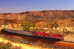 The Ghan, Australia  Renowned as one of the World's greatest train journeys, The Ghan runs the length of Australia from Adelaide in the South to Darwin on the Northern coast. This is the wilderness of the outback at it's best – an ocean of red dirt desert, vibrant aboriginal settlements and vast expanses of unpopulated land. The Ghan also runs through Alice Springs, a popular stopover for tourists wishing to visit Uluru (Ayres rock) and through Flinders ranges and the Katherine Gorge.