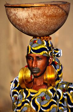 Fulani earrings are a traditional West African jewelry symbolizing wealth and prestige