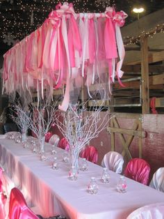 Ceiling decoration. Plastic plumbers piping OR simple wooden sticks with streamers and tulle tied to them and hung with fishing line.