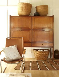 Wood, baskets, leather, stripes. Tobacco brown. James Leland Day via desiretoinspire.