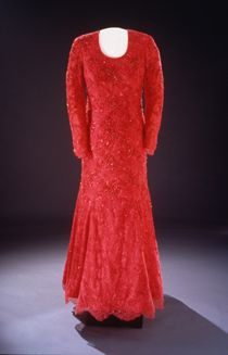 Laura Bush wore this ruby-red gown of crystal-embroidered Chantilly lace over silk georgette to the 2001 inaugural balls. Fellow Texan Michael Faircloth designed the dress.