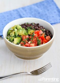 Rice Bowl With Black Beans, Avocado, Tomatoes and Cilantro Lime Dressing