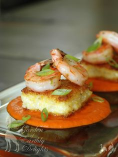 Slap Ya Mama spiced shrimp on seared polenta cakes with roasted red pepper and sundried tomato coulis