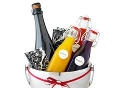 """Instead of arriving at a party with the same old bottle of bubbly, Giada suggests showing up with a Bellini kit filled with champagne and fruit purees. """"You can really use any fruit — bananas and raspberries are also good,"""" she says."""