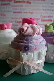 Baby Shower cupcakes made with a receiving blanket, a onesie and a coffee filter!