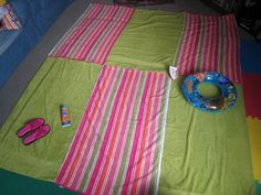 Sew cheap or old towels together to make a blanket!!  For the beach, sew a shower curtain liner to the back.
