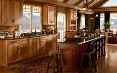 Hickory rustic country kitchen cabinets, the warm tones of hickory cabinets in Honey Spice are enhanced with an island in Cabernet.  Available at Just Cabinets Furniture  More and JustCabinets.com