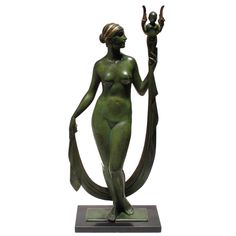 Bronze Nude by Edward Field Sanford  >>>  USA  1929  Art Deco patinated and gilt bronze sculpture of a nude woman holding a cherub. It is a miniature version of a lifesize statue placed in front of the state capital building in Sacramento, California. Signed 'Sanford 1929.'