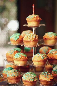 Warm, sweet, lovely orange and green topped cupcakes. #stand #cupcakes #party #food #birthday #orange #green #dessert #baking #cooking #display