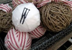 You probably have some extra rags lying around. Put them to use this holiday season and make Christmas ornaments like these Twine and Rag Ball Ornaments. These homemade ball ornaments are simple to make and look cute both hanging on a tree and in a basket.