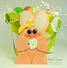You can die cut and punch all the pieces you need from a 6x6 piece of designer paper.  I used both the Oval Collection Framelits (#129381) and 3 different oval punches to create this Easter Bunny and her polka dot Easter egg!  The eyes are punched with the circle from the Itty Bitty Punch Shapes pack (#118309), and the nose is the Small Heart Punch (#117193). Used the Chalk Marker (#132133) on the eyes and a Basic Black marker to draw the whiskers and eyelashes.