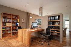 Open plan home office.  Note:  a stainless steel chimney on other side of the wall.