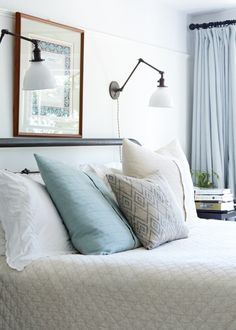 Beautiful blue room with princeton sconces from Schoolhouse Electric