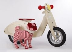 Pug + scooter = happy child. That's it. As a person of reading age, you'll want the details which are striped Stieff doggy (www.gumps.com) and retro wooden scooter from France (www.sfmoma.org). A very happy, merry woof! vroom-vroom, woof! to you, too. Read more » Photo: Russell Yip, The Chronicle / SF
