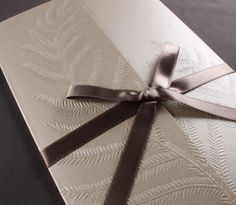 Our Embossed Fern invitation is presented inside an embossed gatefold.