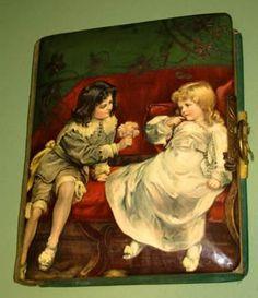 ANTIQUE CELLULOID PHOTO ALBUM -Boy and Girl