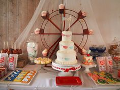 The ferris wheel holding the cupcakes takes this party treats table to the next level! #socialcircus