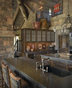 Amazing stone work and other details in this log home kitchen.  Make sure to open the pin to see the best view!