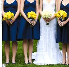 Navy blue bridesmaids dresses, bright yellow flowers, navy & white striped ribbon
