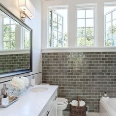 Gray subway tile paired with white trim and bright windows in the bathroom. Robyn Porter, REALTOR, Washington DC metro area #realestate #homes #bathroomideas