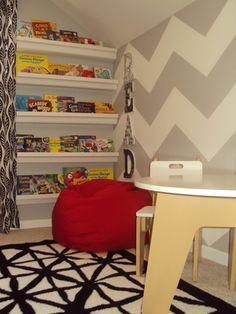 rain gutters as bookshelves!  love this wall