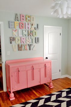 Vintage buffet painted pink and placed in the nursery as a changing table. #Nursery #Vintage #Love