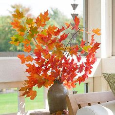 Decorate with a bouquet of autumn leaves. More ideas:  http://www.bhg.com/decorating/seasonal/autumn/fall-harvest-decorating-ideas/