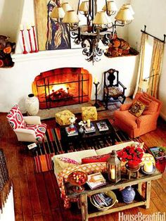 A living room fireplace in Ojai, California. Design: Kathryn M. Ireland. housebeautiful.com. #fireplace #orange #ojai #living_room