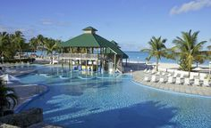 Jolly Beach Resort & Spa in Antigua is great for those who want to get out on the turquoise water. Kayaks, windsurfers, and paddleboats are all at the ready and there are also two pools. (From: Photos: Best Beachfront All-Inclusive Resorts that Fit Your Budget)