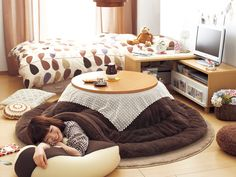 I want a kotatsu! What is it, you say? A kotatsu is the Japanese equivalent of a coffee table, but with a heating element built underneath!