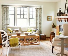 Love the chair and black window moldings. More living room decorating ideas: http://www.bhg.com/decorating/decorating-photos/living-room/