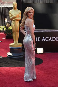 Erin Andrews booty in a long silver shiny gown on red carpet